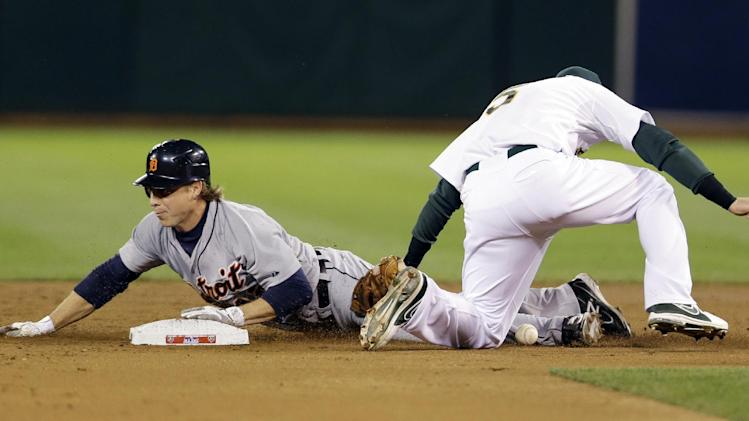 Detroit Tigers Andy Dirks is safe at second on a steal after the ball gets away from Oakland Athletics shortstop Stephen Drew (5) in the second inning of Game 5 of an American League division baseball series in Oakland, Calif., Thursday, Oct. 11, 2012.  (AP Photo/Marcio Jose Sanchez)