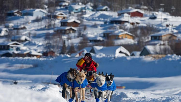 FILE - In this March 9, 2012, file photo, musher Mitch Seavey leaves the Ruby, Alaska, checkpoint during the Iditarod Trail Sled Dog Race. The world's most famous sled dog race kicks off Saturday, March 2, 2013, with an 11-mile-long trot through Alaska's largest city, Anchorage. The competition begins Sunday in Willow. (AP Photo/The Anchorage Daily News, Marc Lester, file)