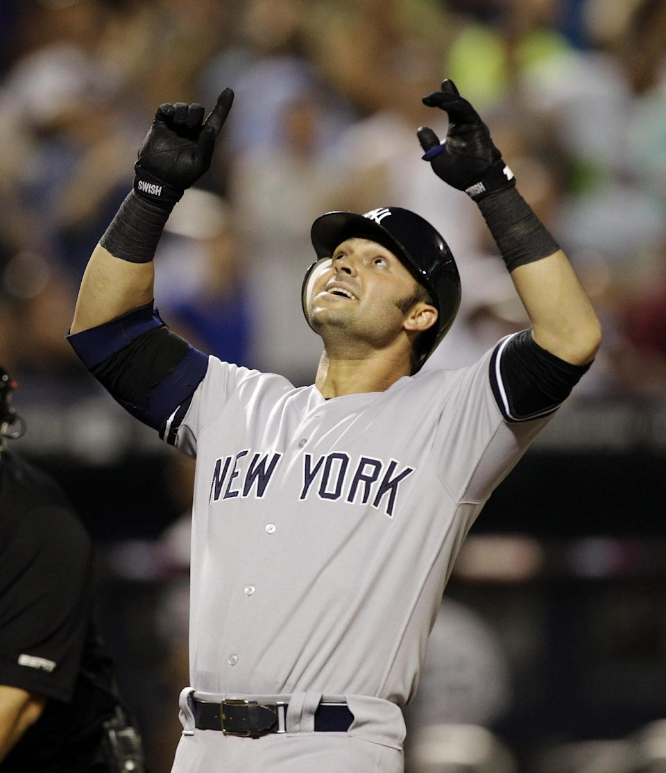 New York Yankees' Nick Swisher reacts at the plate after hitting a third-inning, three-run home run off New York Mets pitcher R.A. Dickey during their interleague baseball game at Citi Field in New York, Sunday, June 24, 2012. (AP Photo/Kathy Willens)