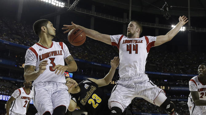 Louisville's Stephan Van Treese (44) vies for a loose ball against Wichita State's Fred Van Vleet (23) as Louisville's Peyton Siva (3) looks on during the second half of the NCAA Final Four tournament college basketball semifinal game Saturday, April 6, 2013, in Atlanta. (AP Photo/Charlie Neibergall)