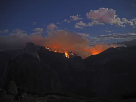 The Meadow Fire burns near Half Dome in Yosemite National Park