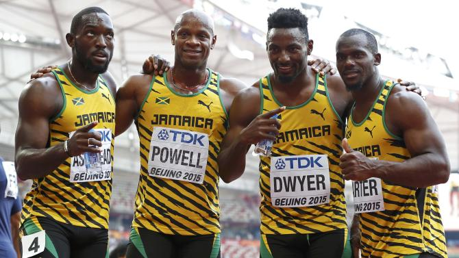Jamaica's Nickel Ashmeade, Asafa Powell, Rasheed Dwyer and Nesta Carter (L-R) celebrate after winning the men's 4 x 100 metres relay heat during the 15th IAAF World Championships at the National Stadium in Beijing