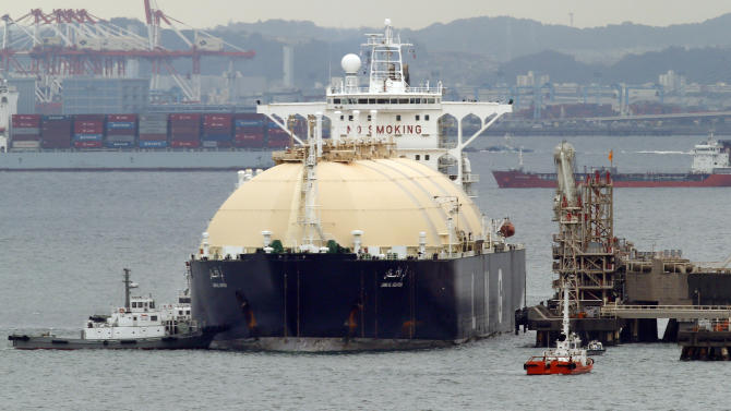 Japan trade deficit widens as imports surge