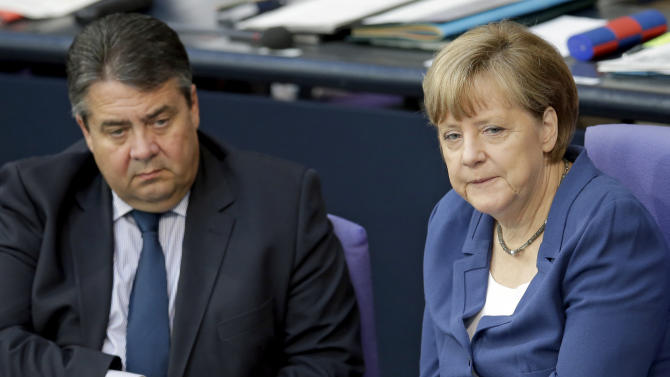 German Chancellor Angela Merkel, right, and Vice Chancellor Sigmar Gabriel, left, attend a meeting of the German federal parliament, Bundestag, in Berlin, Germany, Friday, July 3, 2015. (AP Photo/Michael Sohn)