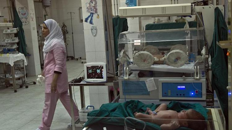 A veiled nurse walks past incubators at the maternity ward of an Islamic charity hospital in southern Cairo's Al-Haram district on January 12, 2014
