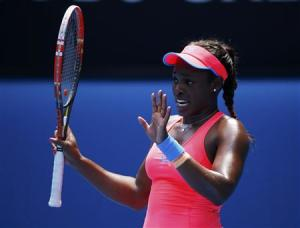 Sloane Stephens of the U.S. apologies to Victoria Azarenka of Belarus for hitting her with the ball during their women's singles match at the Australian Open 2014 tennis tournament in Melbourne