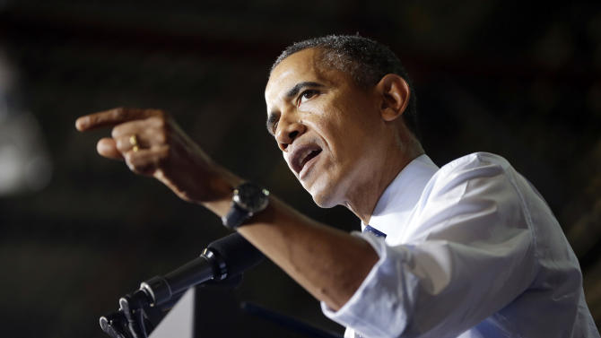 Obama: GOP budget critics holding US 'hostage'