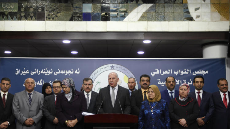 Osama al-Nujaifi, speaker of the Iraqi Council of Representatives, stands with members of parliament from Sunni political bloc Mutahidoon, as he addresses a news conference in Baghdad