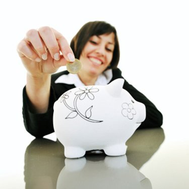 Woman-putting-coins-in-piggybank_web