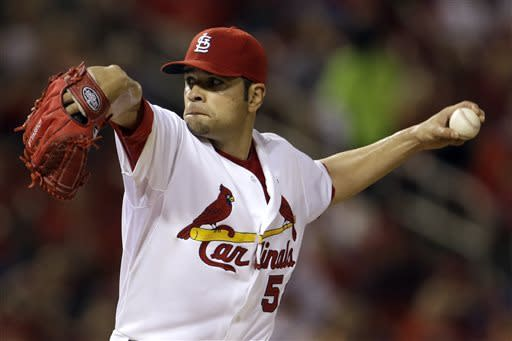 Holliday, Garcia lead Cards to 2-1 win over Reds