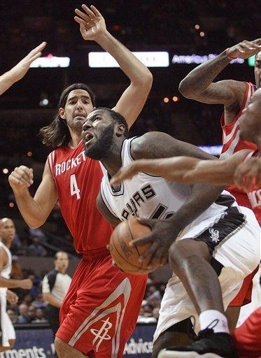 Duncan scores 19 to lead Spurs over Rockets 97-95