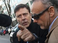 "Dr Eufemiano Fuentes (L) arrives at the court house in Madrid on Monday. Among the five defendants facing charges of an ""offence against public health"", the most prominent is the suspected mastermind of the network, 57-year-old doctor Eufemiano Fuentes"