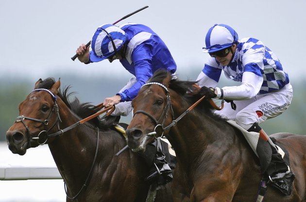 Doyle on his mount Al Kazeem wins the Prince of Wales's Stakes ahead of Hanagan riding Mukhadram on the second day of the Royal Ascot horse racing festival at Ascot