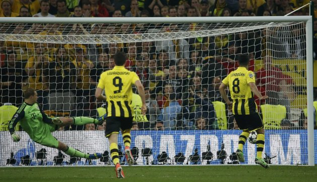 Borussia Dortmund's Guendogan scores a penalty past Bayern Munich's goalkeeper Neuer during their Champions League Final soccer match at Wembley Stadium in London