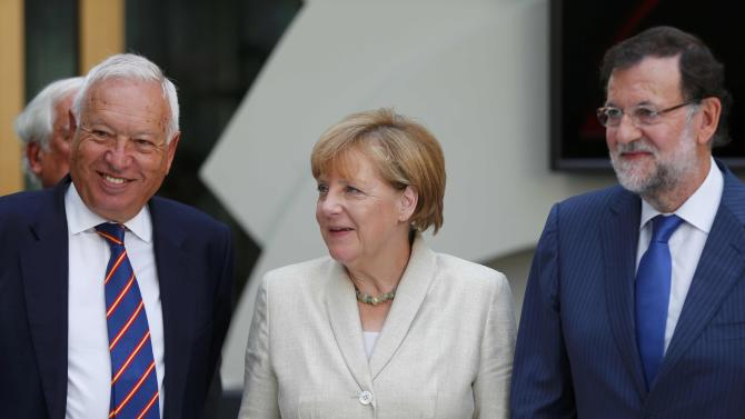 German Chancellor Merkel, Spanish Prime Minister Rajoy and Spanish Foreign Minister Garcia-Margallo arrive for a German-Spanish business meeting in Berlin