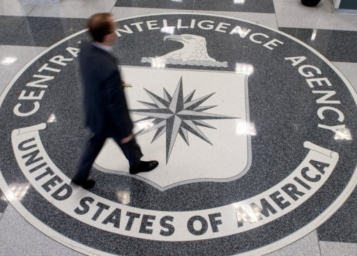 A man crosses the Central Intelligence Agency logo in the lobby of CIA Headquarters in Langley, Virginia, on August 14, 2008. Two Americans wounded when their US embassy vehicle came under fire in Mexico were employed by the Central Intelligence Agency as part of an anti-drug task force, The New York Times reported Wednesday.