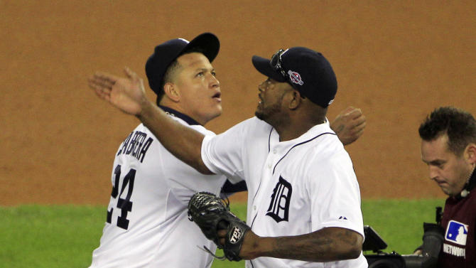 Detroit Tigers relief pitcher Jose Valverde, right, and teammate Miguel Cabrera celebrate after the last out in the ninth inning of Game 1 of the American League division baseball series against the Oakland Athletics, Saturday, Oct. 6, 2012, in Detroit. The Tigers won 3-1. (AP Photo/Carlos Osorio)
