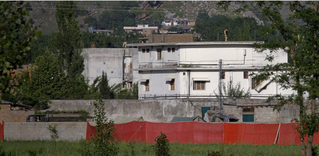 A Pakistan army soldier stands on top of the house where it is believed al-Qaida leader Osama bin Laden lived in Abbottabad, Pakistan on Monday, May 2, 2011. Bin Laden, the mastermind behind the Sept.