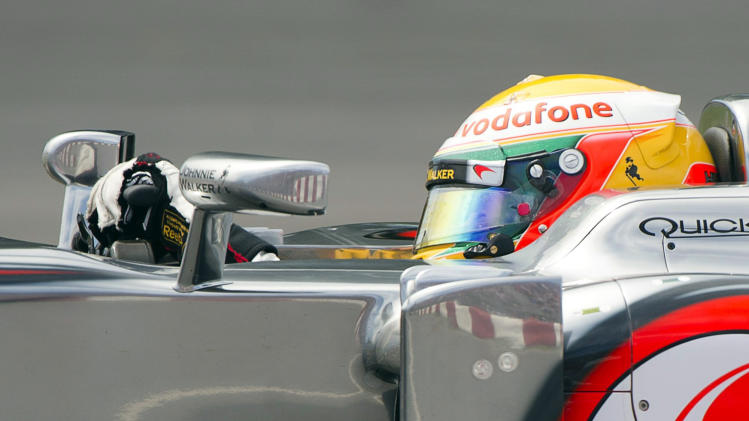 McLaren driver Lewis Hamilton, of Britain, makes his way through the Senna Corner during Formula One's Canadian Grand Prix auto race at Circuit Gilles Villeneuve on Sunday, June 10, 2012, in Montreal. (AP Photo/The Canadian Press, Paul Chiasson)