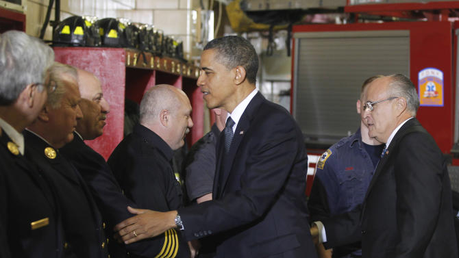 In this May 5, 2011 file photo, President Barack Obama and former New York City Mayor Rudy Giuliani, right, meet with firefighters and first responders at Engine 54, Ladder 4, Battalion 9 before visiting the National Sept. 11 Memorial at Ground Zero in New York. Giuliani has relentlessly criticized President Barack Obama in recent weeks, questioning the commander in chief's love of country while placing the blame for much of society's ills at the front door of the White House. But those same inflammatory views that have been eaten up by some conservatives are significantly out of step with the prevailing political views of liberal New York City, and experts suggest they could further muddle Giuliani's complicated legacy in the city he led for eight years, including in its darkest hours. (AP Photo/Charles Dharapak, File)
