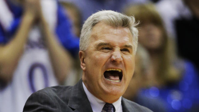 Kansas State head coach Bruce Weber yells to his team during the first half of an NCAA college basketball game against Kansas in Lawrence, Kan., Monday, Feb. 11, 2013. (AP Photo/Orlin Wagner)