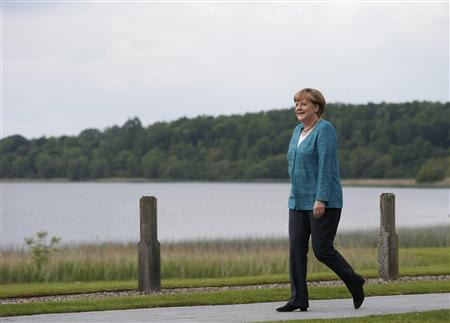 Germany's Chancellor Angela Merkel arrives at the Lough Erne golf resort where the G8 summit is taking place in Enniskillen