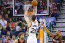 Utah Jazz forward Gordon Hayward (20) shoots as Portland Trail Blazers guard Damian Lillard (0) defends in the second quarter during an NBA basketball game Friday, Feb. 20, 2015, in Salt Lake City. (AP Photo/Rick Bowmer)