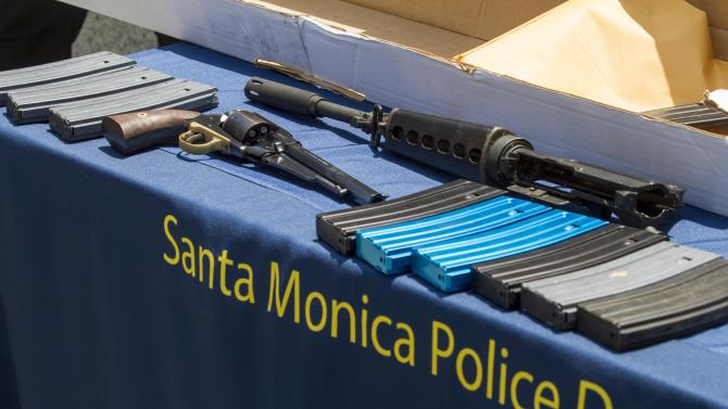 Weapons recovered from Santa Monica College are displayed during a news conference held by Santa Monica Police, Saturday June 8, 2013, in Santa Monica, Calif., Santa Monica Police Chief Jacqueline Seabrooks says the gunman who killed four people in a chaotic rampage planned the attack and had 1,300 rounds of ammunition.  (AP Photo/Ringo H.W. Chiu)