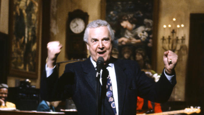 """This March 14, 1992 photo provided by NBC shows announcer Don Pardo on the set of """"Saturday Night Live."""" Pardo, the durable television and radio announcer whose resonant voice-over style was widely imitated and became the standard in the field, died Monday, Aug. 18, 2014 in Arizona at the age of 96. (AP Photo/NBC, Al Levine)"""