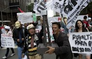&lt;p&gt;People shout slogans during a demonstration in Rio demanding Brazilian President Dilma Roussef veto a bill that would redistribute oil royalties in favor of non-oil producing states.&lt;/p&gt;
