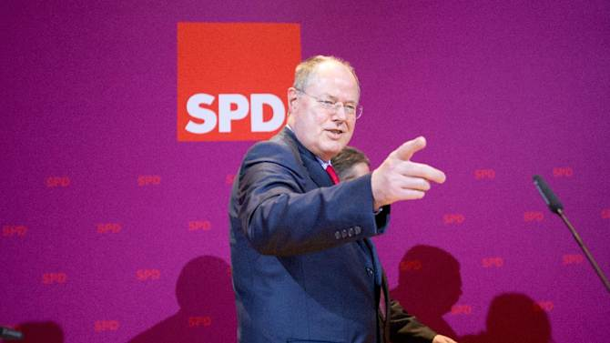 Social Democratic Party (SPD) top candidate for the upcoming general elections Peer Steinbrueck reacts after the first exit polls of  the state election in Lower Saxony in the party's headquarters in Berlin, Sunday, Jan. 20, 2013. (AP Photo/dpa, Kay Nietfeld)