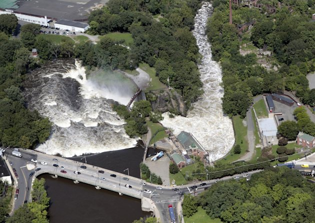 Water from the Passaic River is seen flowing over the Great Falls as the river has overrun it's banks and flood following Hurricane Irene in Paterson