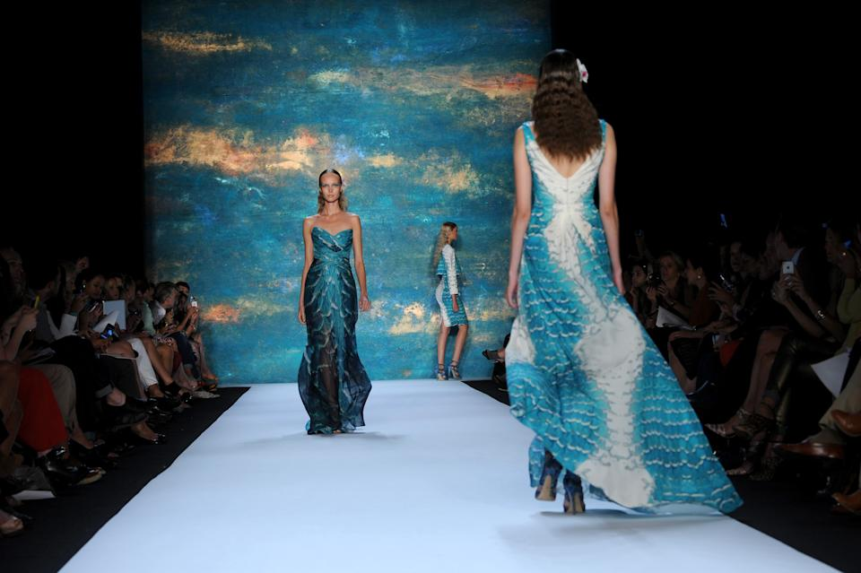 Models walk the runway at the Monique Lhuillier spring 2013 show, Saturday, Sept. 8, 2012, during Fashion Week in New York. (AP Photo/Diane Bondareff)