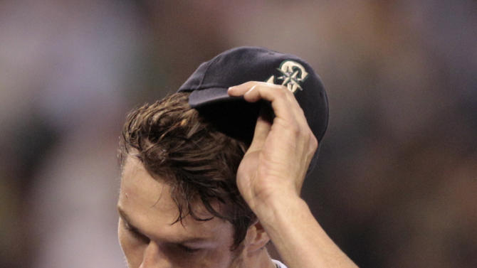 Seattle Mariners starting pitcher Doug Fister pulls off his cap as he heads into the dugout after throwing against the San Diego Padres in the ninth inning in a baseball game Saturday, July 2, 2011, in Seattle. The Padres won 1-0. (AP Photo/Elaine Thompson)