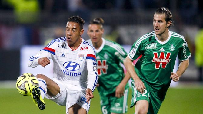Olympique Lyon's Tolisso challenges Saint-Etienne's Clerc during their French Ligue 1 soccer match at the Gerland stadium in Lyon