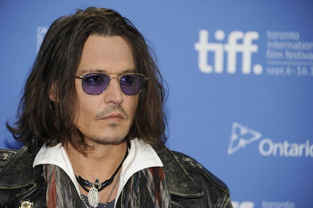 FILE - In this Sept. 8, 2012 file photo, actor Johnny Depp participates in a photo call and press conference for the film &quot;West of Memphis&quot; at TIFF Bell Lightbox during the Toronto International Film Festival, in Toronto. HarperCollins Publishers announced Monday, Oct. 15, 2012, that Depp will help run an imprint that will be a home for authentic, outspoken and visionary books. (Photo by Evan Agostini/Invision/AP, File)