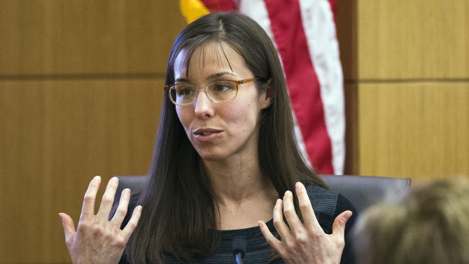 FILE - This March 5, 2013 file photo shows Jodi Arias gesturing toward the jury, in Maricopa County Superior Court in Phoenix.  Arias is on trial for the murder of Travis Alexander in 2008.  Arias lied repeatedly throughout her evaluation conducted by a psychologist hired by the defense, who diagnosed her with amnesia and post-traumatic stress disorder, but most of the falsities were irrelevant to his ultimate conclusions about her mental state, the psychologist testified Tuesday March 19, 2013, at Arias' murder trial.(AP Photo/The Arizona Republic,Tom Tingle, Pool, file)