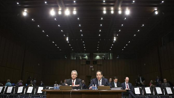 Deputy Secretary of State William Burns, left, who is in charge of policy, and Deputy Secretary of State Thomas Nides, right, who is in charge of management, appear before the Senate Foreign Relations Committee about the attack on the consulate in Benghazi, Libya, where the U.S. ambassador and three other Americans were killed on Sept. 11, on Capitol Hill in Washington, Thursday, Dec. 20, 2012. Secretary of State Hillary Rodham Clinton had been scheduled to testify but canceled after fainting and sustaining a concussion last week.  (AP Photo/J. Scott Applewhite)