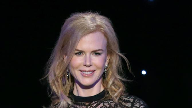 IMAGE DISTRIBUTED FOR THE PRODUCERS GUILD - Nicole Kidman presents the Zanuck award for outstanding producer of theatrical motion pictures at the 24th Annual Producers Guild (PGA) Awards at the Beverly Hilton Hotel on Saturday Jan. 26, 2013, in Beverly Hills, Calif. (Photo by Todd Williamson/Invision for The Producers Guild/AP Images)