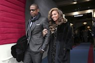 Recording artists Jay-Z and Beyonce arrive on the West Front of the Capitol in Washington, Monday, Jan. 21, 2013, for the Presidential Barack Obama&#39;s ceremonial swearing-in ceremony during the 57th Presidential Inauguration. (AP Photo/Win McNamee, Pool)