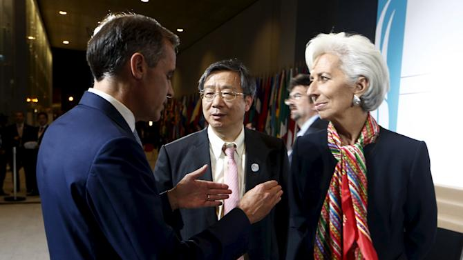 German Bundesbank President Weidmann, People's Bank of China Deputy Governor Yi and IMF Managing Director Lagarde talk after a family picture of the G-20 group at the 2015 IMF/World Bank Annual Meetings in Lima, Peru
