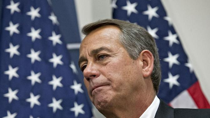 """House Speaker John Boehner of Ohio, who conferred with President Barack Obama by phone yesterday, listens during a news conference on Capitol Hill in Washington, Wednesday, Dec. 12, 2012,  following a closed-door meeting with the GOP caucu. Boehner and the other House Republican leaders are calling for Obama to come up with plan they can accept for spending cuts and tax revenue to avoid the so-called """"fiscal cliff"""" of automatic tax hikes and budget reductions. (AP Photo/J. Scott Applewhite)"""