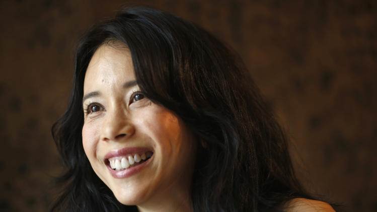 "Hong Kong actress Karen Mok smiles during an interview with the Associated Press at a hotel in Hong Kong Thursday, Jan. 31, 2013. Karen Mok is releasing a jazz album and filming Keanu Reeves's directorial debut ""Man of Tai Chi."" (AP Photo/Vincent Yu)"