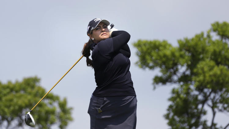 Lizette Salas tees off the 10th hole during the first round at the U.S. Women's Open golf tournament at Sebonack Golf Club in Southampton, N.Y., Thursday, June 27, 2013. (AP Photo/Seth Wenig)