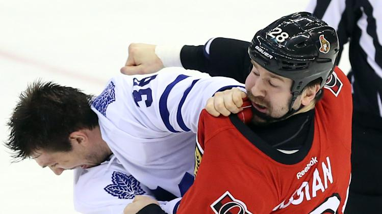 Ottawa Senators' Matt Kassin (28) fights with Toronto Maple Leafs' Frazer McLaren (38) during the first period of an NHL hockey game in Ottawa, Ontario, Saturday, April 20, 2013. (AP Photo/The Canadian Press, Fred Chartrand)