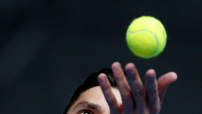 Milos Raonic of Canada serves to Feliciano Lopez of Spain during their fourth round match at the Australian Open tennis championship in Melbourne, Australia, Monday, Jan. 26, 2015. (AP Photo/Vincent Thian)