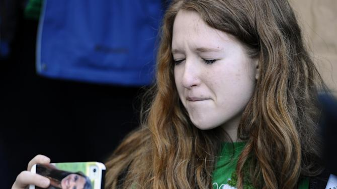 Sarah Clements of Newtown, Conn. uses a cell phone with a picture of Sandy Hook Elementary School shooting victim Victoria Soto on it,  to record the family speaking during a rally at the Capitol in Hartford, Conn., Thursday, Feb. 14, 2013. Thousands of people turned out to call on lawmakers to toughen gun laws in light of the December elementary school shooting in Newtown that left 26 students and educators dead. Clements' mother is a second grade teacher at Sandy Hook Elementary School and she knew Victoria Soto. (AP Photo/Jessica Hill)