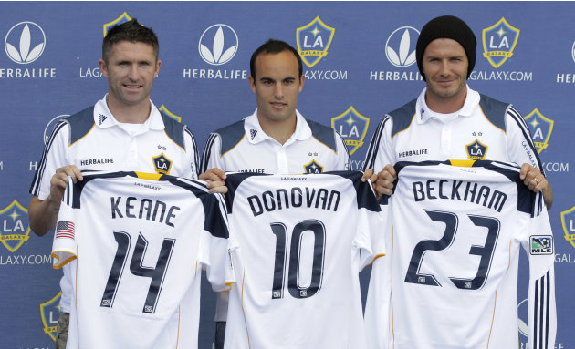 Los Angeles Galaxy players, from left, Robbie Keane, of Ireland, Landon Donovan and David Beckham pose with their jerseys during an MLS news conference at Home Depot Center in Carson, Calif., on Frida