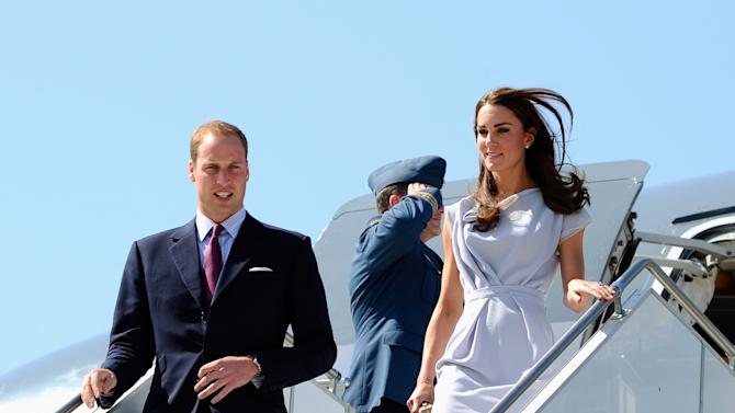 Prince William and Kate, the Duke and Duchess of Cambridge, arrive at Los Angeles International Airport in Los Angeles on Friday, July 8, 2011. (AP Photo/Kevork Djansezian, pool)