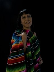 Rocio Ramirez poses for a portrait with a colorful Mexican shawl covering one side of her near naked body, revealing her erotic side to prove that HIV has not robbed her sexuality and self-esteem